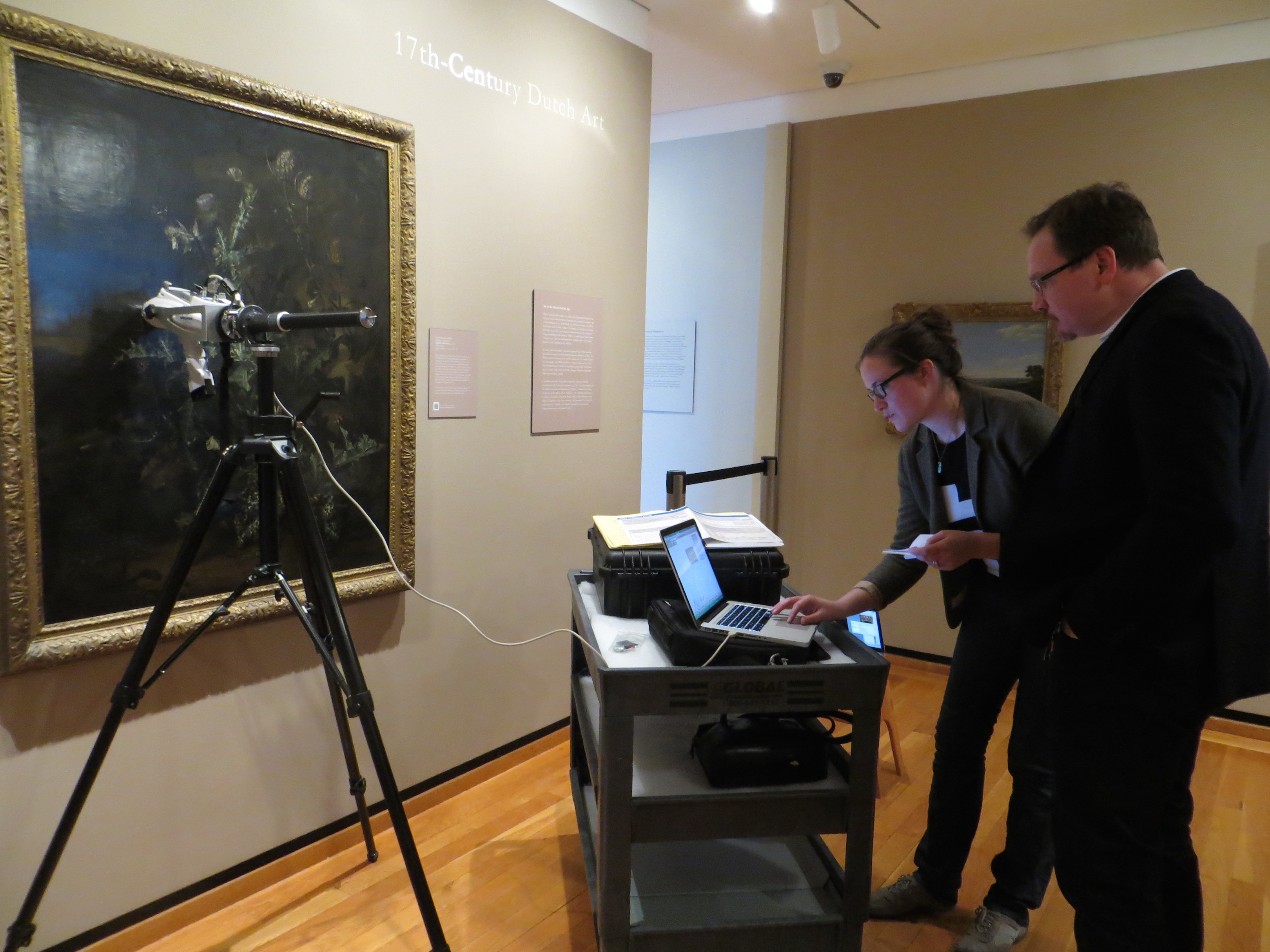 Dr. Louisa Smieska (CHESS) and Dr. Andrew Weislogel (Johnson Museum) use the pXRF to examine van Schrieck's Still Life with Thistle (ca. 1670).
